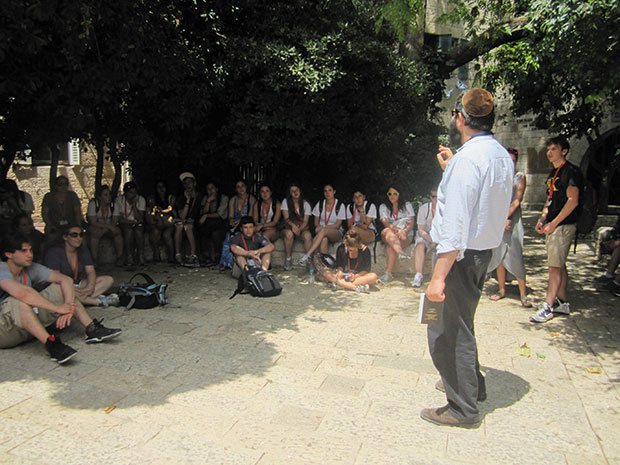 Standing in the Old City of Jerusalem, Rabbi Hersh Novack lectures to a group of Washington University and St. Louis area college students during a recent Taglit Birthright Israel trip. Birthright Israel is a partnership between the Jewish Federations, the Jewish Agency, and leading individual philanthropists.