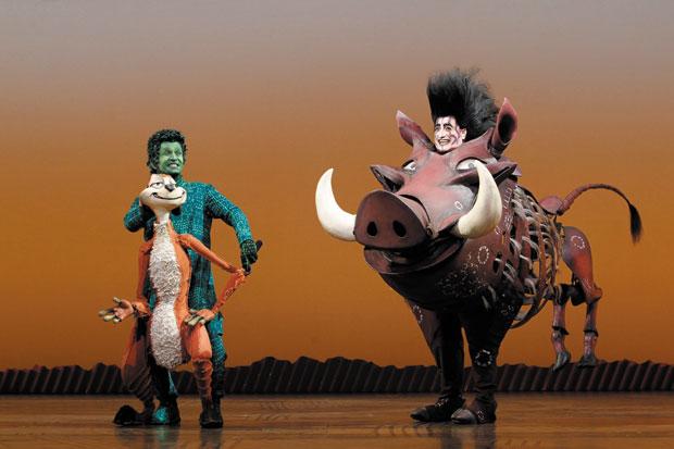 Ben Lipitz, right, portrays the character Pumbaa alongside Nick Cordileone as Timon. Photo: Joan Marcus