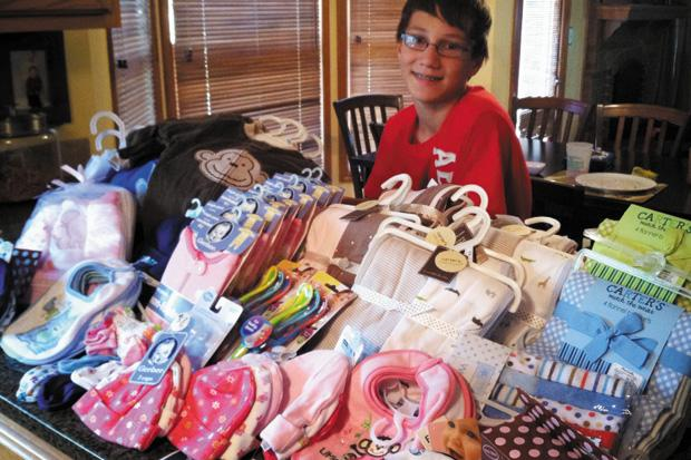 For+his+mitzvah+project%2C+Jacob+supported+Small+World+Adoption+Foundation%2C+the+organization+that+helped+bring+him+to+America+from+Minsk%2C+Belarus.+Jacob%C2%A0Lentin+held+a+bake+sale+to+raise+money+to+purchase+clothing+for+the+children+in+the+orphanages+overseas.%0A