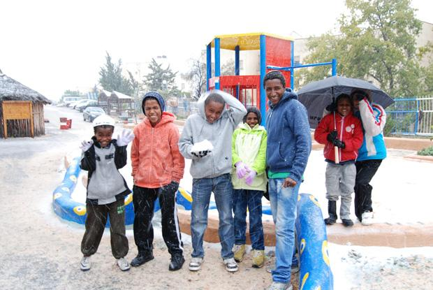 Hundreds of Ethiopianolim(immigrants) living in The Jewish Agency for Israel absorption centers in Safed experienced snow today for the first time. The children pictured headed outside to play in the snow and feel the natural marvel with their own hands at the start of the snow storm, which has blanketed the city.Three Jewish Agency absorption centers are located in Safed which house 2,000 immigrants from Ethiopia, who The Jewish Agency brought to Israel in recent months. Theolimarrived as a part of Operation Dove's Wings, which will bring the Ethiopian Aliyah to a close.