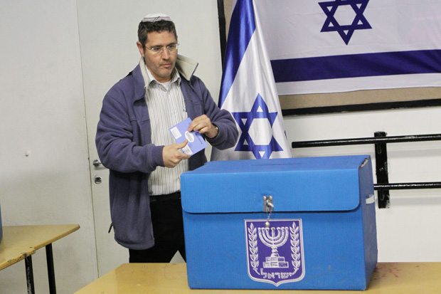 An+Israeli+man+casting+his+vote+at+a+polling+station+in+Jerusalem%2C+Jan.+22%2C+2013.+Photo%3A+Miriam+Alster%2FFLASH90%2FJTA%0A
