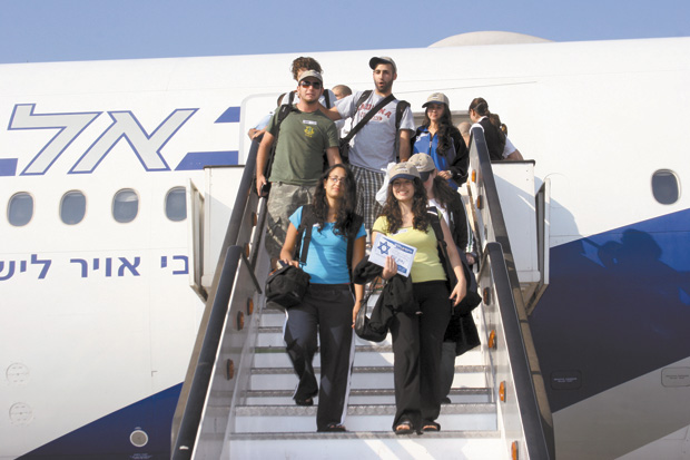 A+few+immigrants+to+Israel+stepping+out+of+the+plane+at+Ben+Gurion+Airport.%C2%A0
