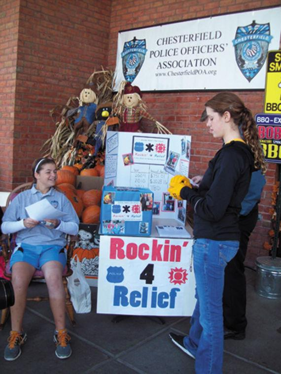At+the+2011+Rockin%E2%80%99+For+Relief%2C%C2%A0+Jennifer+helps+fundraise+from+Dierbergs+shoppers.+%28Photo+by+Mia+Kweskin%29%C2%A0