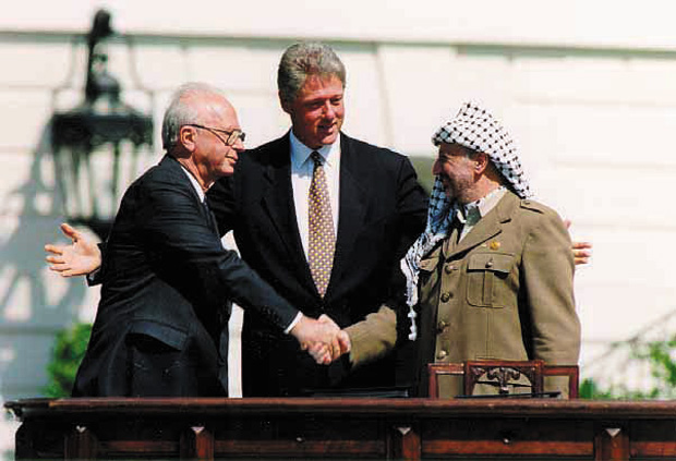 Yitzhak+Rabin%2C+Bill+Clinton%2C+and+Yasser+Arafat+at+the+signing+of+the+Oslo+Accords+on+Sept.+13%2C+1993.%C2%A0