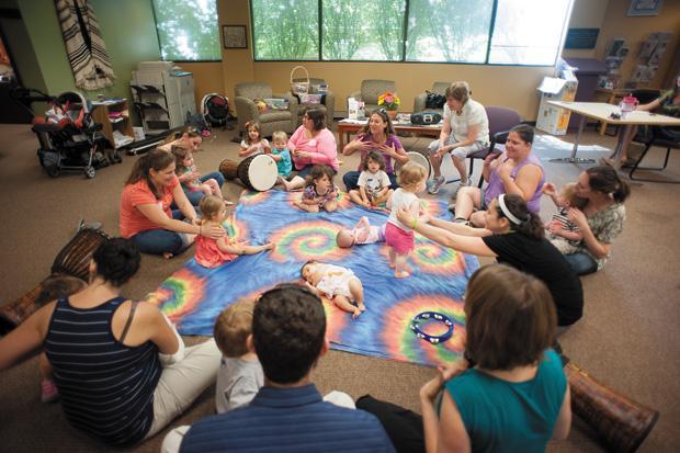 Shelley Dean (center) leads a Rhythm 'N' Ruach class at the Saul Brodsky Jewish Community Library.