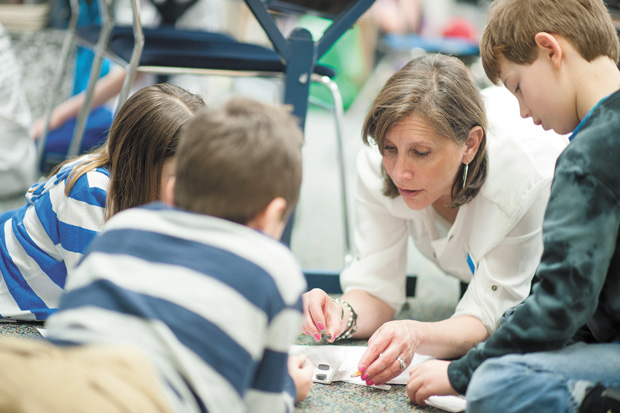 Saul Mirowitz Jewish Community School teacher Sue Lapp working with third-grade students Ilana Boyer, Adli Jacobs and Isaac Benjamin during the school's first STEAM day.