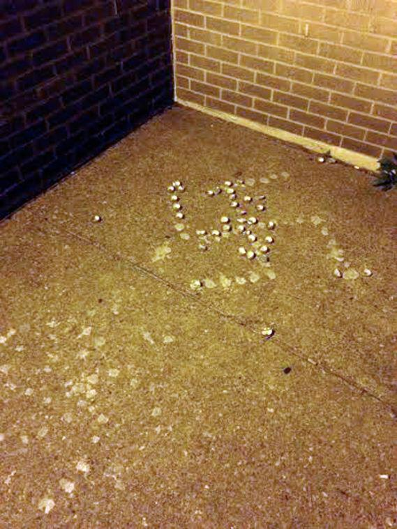 A swastika formed of votive candles found outside a SLU residence hall.