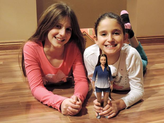 Nickolay Lamm's cousins play with a prototype of the Lammily doll