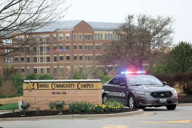 A police car is seen at the entrance of the Jewish Community Campus after three were killed when a gunman opened fire on April 13, 2014 in Overland Park, Kansas.