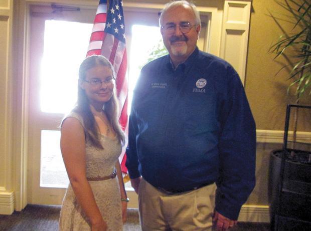 Emily Rosenblum and FEMA Administrator Craig Fugate.