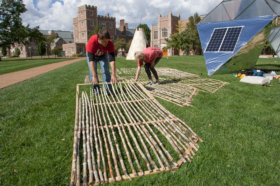 University of Louisana at Lafayette graduate student Garrett Armentor and professor Ashlie Latiolais work on constructing Latiolais' sukkah design on Oct. 6, 2014 at Washington University. Latiolais' design was one of 10 finalists in Sukkah City STL, held by St. Louis Hillel and Wash U. The teams constructed their sukkot on the quadrangle just west of the university's Olin Library.