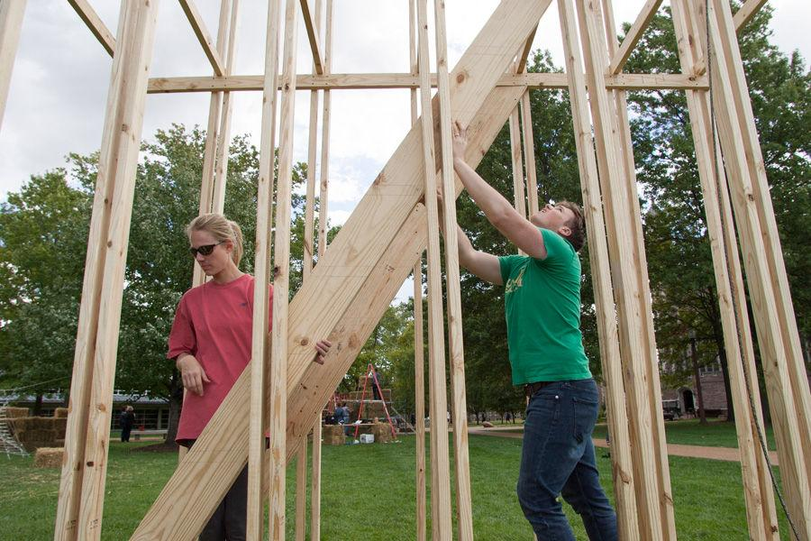 University of Louisiana at Lafayette graduate student John Welcher and professor Ashlie Latiolais work on constructing Latiolais' sukkah design on Oct. 6, 2014 at Washington University. Latiolais' design was one of 10 finalists in Sukkah City STL, held by St. Louis Hillel and Wash U. The teams constructed their sukkot on the quadrangle just west of the university's Olin Library.
