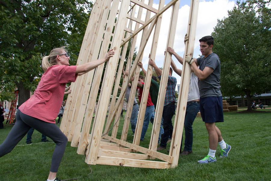 University of Louisiana at Lafayette professor Ashlie Latiolais gets help from her team and the Kansas State team in raising the 14-foot structure of Latiolais' sukkah design on Oct. 6, 2014 at Washington University. Latiolais' design was one of 10 finalists in Sukkah City STL, held by St. Louis Hillel and Wash U. The teams constructed their sukkot on the quadrangle just west of the university's Olin Library.