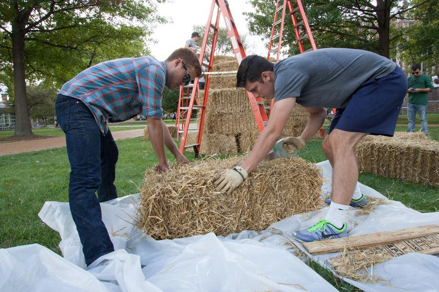 Kansas State architecture students Brian Delaney (plaid shirt) and Brandon Eversgerd work on constructing fellow student (not pictured) Devin Brown's sukkah design on Oct. 6, 2014 at Washington University. Brown's design, made of hay bales, was one of 10 finalists in Sukkah City STL, held by St. Louis Hillel and Wash U. The teams constructed their sukkot on the quadrangle just west of the university's Olin Library.