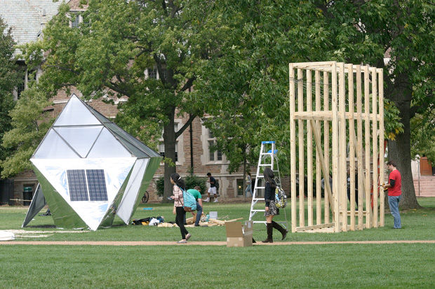 Washington University students walk by two of 10 winning sukkah designs being constructed Monday in the quadrangle just west of the university's Olin Library as part of the Sukkah City STL competition. Held by Washington University and St. Louis Hillel, the 10 winning sukkot will be on display through Oct. 12. A variety of Jewish community events have been planned as part of Sukkah City STL. For full details, visit http://bit.ly/sukkah-city. The holiday of Sukkot begins at sundown Wednesday. Photo: Mike Sherwin