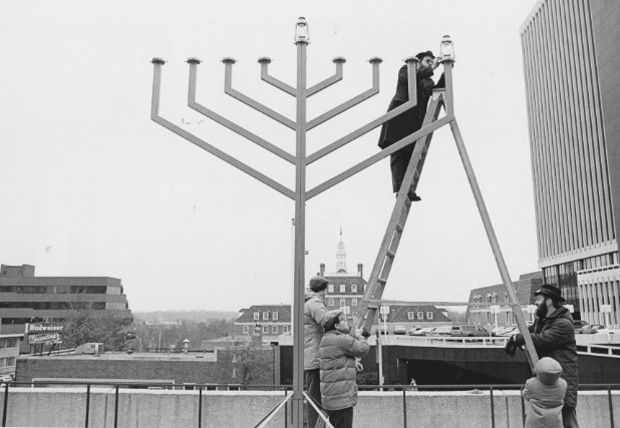 Rabbi Yosef Landa, Director of Chabad of Greater St. Louis, kindles a large menorah on the plaza of the St. Louis County Government Center in December, 1986. Photo: David Henschel