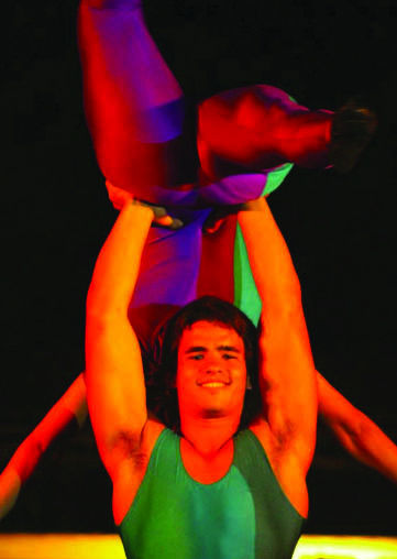 With+a+bright+smile+on+his+face%2C+Israeli+acrobat+Yahel+Retter+shows+off+his+skills+by+lifting+another+performer+over+his+head+into+the+air.+Photo+courtesy+of+Omar+Rott.