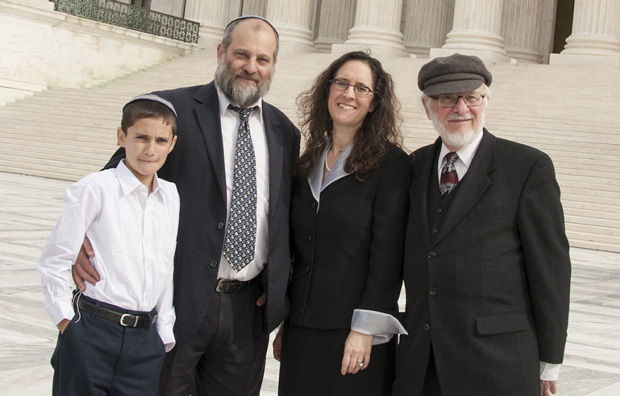 Menachem+Zivotofsky%2C+left%2C+and+his+father+Ari+posing+in+front+of+the+Supreme+Court+with+their+attorney+Alyza+Lewin+and+Lewins+father+Nathan%2C+Nov.+3%2C+2014.+%28Rikki+Gordon+Lewin%29%C2%A0