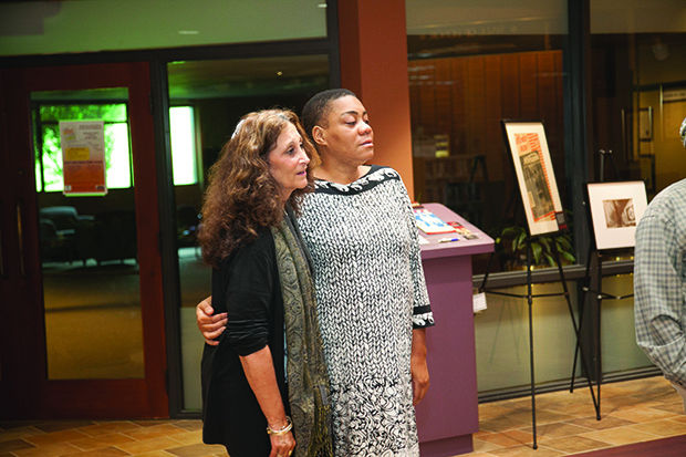 Rabbi+Susan+Talve+and+Rev.+Melissa+Bennett+listen+as+KB+Frazier+sings+during+a+vigil+for+the+victims+of+the+Charleston+church+shootings%2C+held+at+the+Jewish+Federation+on+June+18.+Photo%3A+Andrew+Kerman