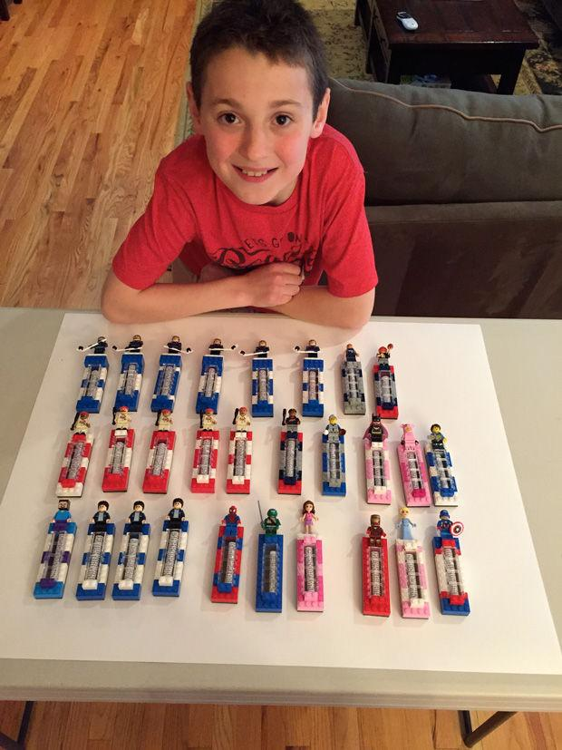 Josh+Fingerman+displays+some+of+his+mezuzahs+made+from+Legos.+For+his+mitzvah+project%2C+Josh+sells+the+mezuzahs+to+raise+funds+for+three+nonprofit+organizations.