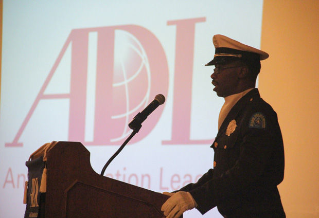 St.+Louis+Police+Officer+John+Leggette+is+silhouetted+against+a+video+screen+as+he+sings+the+national+anthem+during+a+Anti-Defamation+League+luncheon+held+July+30+at+the+Chase+Park+Plaza.%C2%A0+The+event+marked+the+10th+anniversary+of+Law+Enforcement+and+Society%3A+Lessons+of+the+Holocaust%2C+a+program+held+by+the+ADL+and+the+Holocaust+Museum+and+Learning%C2%A0+Center+of+St.+Louis.+Photos%3A+Philip+Deitch%C2%A0