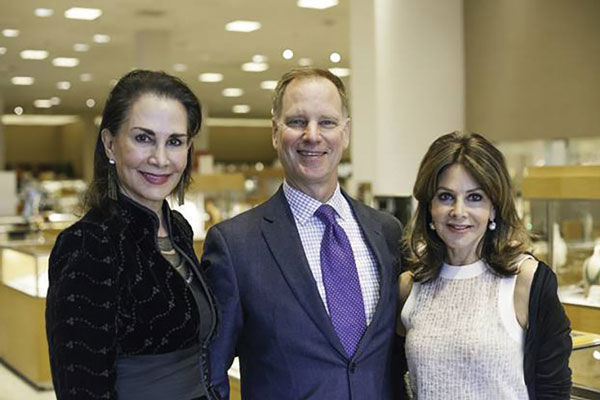 Sheri Sherman (left) and Faith Berger (right) are co-chairs of a March 9 fundraiser for Midwest Children's Burn Camp. At center is Allen Barber of Neiman Marcus, where the fundraiser will be held.
