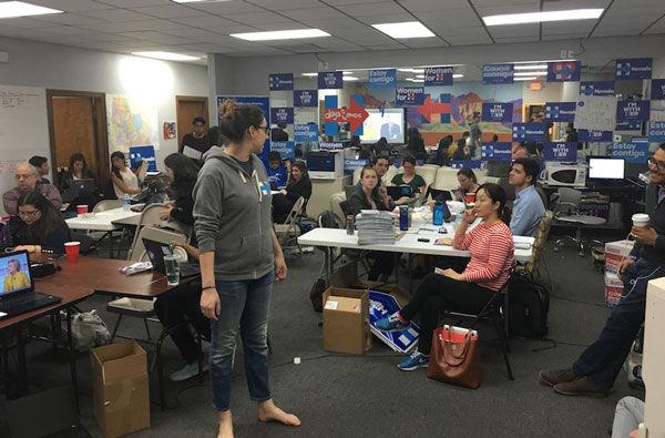 Volunteers+working+the+phones+at+a+suburban+Las+Vegas+office+of+the+Hillary+Clinton+campaign+while+watching+a+debate+between+Clinton+and+Sen.+Bernie+Sanders%2C+Feb.+11%2C+2016.+%28Ron+Kampeas%29