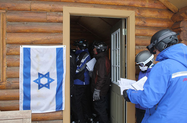 An+Israeli+flag+is+posted+at+Deer+Valley%E2%80%99s+Sunset+Cabin+every+Friday+afternoon+to+alert+skiers+to+the+weekly+Kabbalat+Shabbat+service.+%28Uriel+Heilman%29