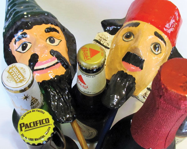 Groggers+and+beer%2C+two+important+elements+of+a+Purim+celebration+%28Edmon+J.+Rodman