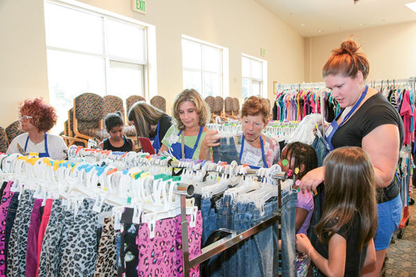 Volunteers help children pick out items at the 2014 Back-to-School Store! of the National Council of Jewsh Women-St. Louis Section. File photo: Kristi Foster