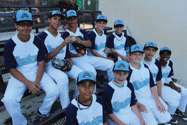 Jacob Steinmetz, back row, second from right, and his Brooklyn Bluestorm teammates are headed to the Elite World Series in Florida after going 24-0 this season. (Hillel Kuttler)