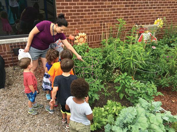 Children at Shaare Emeth's Shirlee Green Preschool check out the mitzvahgarden outside. The preschool was recently recognized nationally as a 'Certified NatureExplore Classroom.'