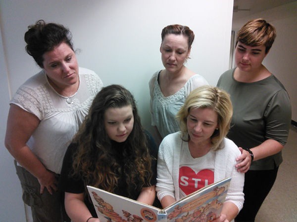 From left: Kelley Weber, Hannah Ryan, Kirsten DeBroux, Michelle Hand and Katy Keating rehearsefor Mustard Seed Theatre's upcoming production of 'Kinder-transport.'