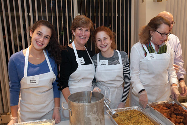 From+left%2C+Jennifer%2C+Susan+and+Lauren+Goldberg+and+Carol+Cohen+are+ready+to+serve+dinner+at+Temple+Israel+the+night+before+Thanskgiving.+Temple+Israel+has+been+serving+a+holiday+meal+to+the+less+fortunate+for+three+decades+and+counting.+Photo%3A+Andrew+Kerman