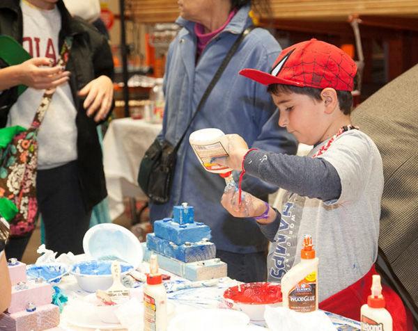 A+paticipant+crafts+a+menorah+at+a+previous+Hanukkah+workshop+at+Home+Depot.%C2%A0Photo%3A+Andrew+Kerman