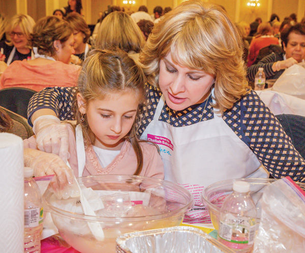 Tehilla+and+Elisheva+Raskas+make+challah+dough+during+the+Great+Big+Challah+Bake+of+St.+Louis+on+Nov.+10+at+the+Clayton+Plaza+Hotel.+The+event+drew+close+to+500+people.+Photo%3A+Kristi+Foster