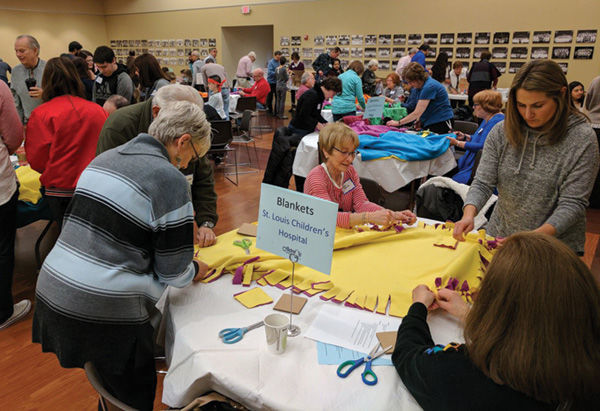 Service+projects+are+underway+at+United+Hebrew+Congregation+during+the+sixth+annual+Jewish-Muslim+Day+of+Service+on+Dec.+25.+United+Hebrew+was+one+of+25+volunteer+service+sites.+Photo+courtesy+UH