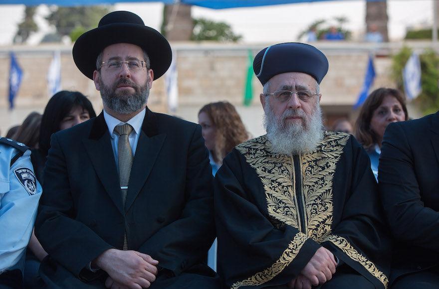 Ashkenazi+Chief+Rabbi+David+Lau%2C+left%2C+and+Sephardi+Chief+Rabbi+Yitzhak+Yosef+attending+a+New+Year%E2%80%99s+ceremony+at+the+national+headquarters+of+the+Israel+Police+in+Jerusalem%2C+Sept.+7%2C+2015.+%28Yonatan+Sindel%2FFlash90%29