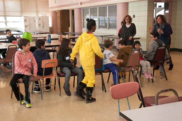 Shaare Emeth volunteers play a game of musical chairs during a recent 'Winter Fun Day' event for immigrant families at the International Institute. The congregation partnered with the institute on a 'New Americans' project, which provides services for immigrants in St. Louis.