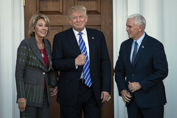 President-elect+Donald+Trump+is+flanked+by+education+secretary+nominee+Betsy+DeVos+and+Vice+President-elect+Mike+Pence+outside+the+clubhouse+at+Trump+International+Golf+Club+in+Bedminster+Township%2C+N.J.%2C+on+Nov.+19.%C2%A0+Photo%3A+Drew+Angerer%2FGetty+Images