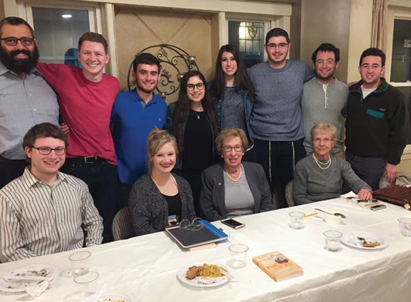 Eva Schloss (third from bottom left), a Holocaust survivor and the stepsister of Anne Frank, is shown with students during a visit to Washington University last week. At top left is Rabbi Hershey Novack of Chabad on Campus, which sponsored Schloss' visit.