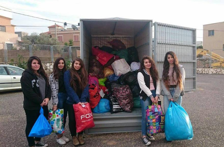 Israeli+volunteers+packing+winter+supplies+to+be+delivered+to+Syrian+Refugees.+%28Operation+Human+Warmth%29