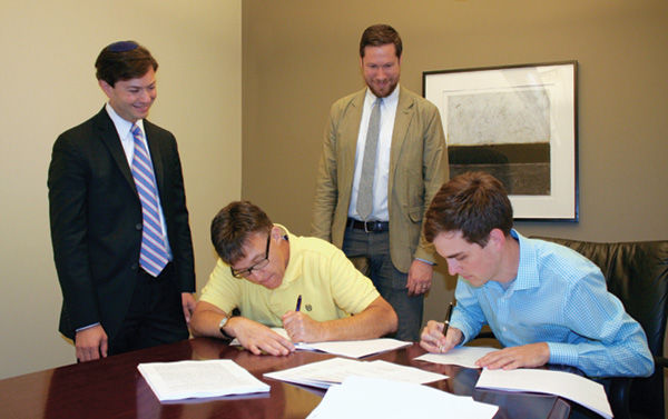 At the September 2015 signing of the building exchange are (from left) Kol Rinah Rabbi Noah Arnow, Kol Rinah President Mitch Shenker, The Journey Lead Pastor Jeremy Irwin, and The Journey Director of Operations Mike Duncan.