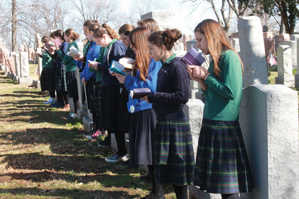 Torah+Prep+School+of+St.+Louis+students+read+a+prayer+after+placing+rocks+atop+headstones+at+Chesed+Shel+Emeth+Cemetery+in+response+to+the+recent+vandalism.%C2%A0+For+video+clips+of+the+project%2C+visit+stljewishlight.com%2Fmultimedia.+Photos%3A+Eric+Berger