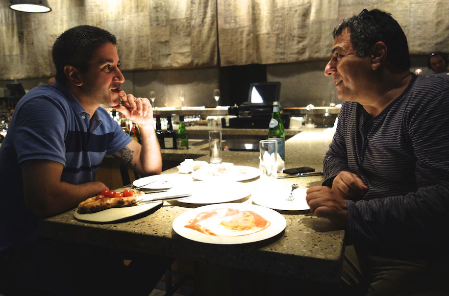 Michael+Solomonov%2C+left%2C+the+star+of+a+new+documentary+about+Israeli+cuisine%2C+is+seen+here+with+Haim+Cohen%2C+a+chef%2C+TV+host%2C+cookbook+writer+and+restaurateur%2C+in+Tel+Aviv-Jaffa.+%28Florentine+Films%29