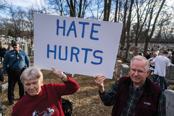 Darlene+and+Paul+Schroeder+hold+a+placard+at+the+Chesed+Shel+Emeth+Cemetery+cleanup+event+Feb.+22.+Photo%3A+James+Griesedieck