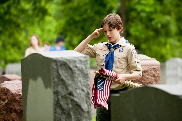 On Memorial Day weekend in 2014, Tom Churchill gives a salute after placing a flag salute after placing a flag at a veteran's grave at Chesed Shel Emeth cemetery. Each year, the Boy Scouts partner with Jewish War Veterans' local post to distribute flags at the graves of all veterans at local Jewish cemeteries. That year, scouts placed flags at more than 6,000 graves at seven local Jewish cemeteries. Photo: Lisa Mandel