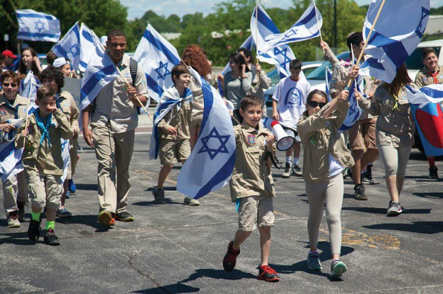 Young+participants+wave+Israeli+flags+at+the+%E2%80%98Walk+in+Support+of+Israel%E2%80%99+held+Sunday+at+the+I.E.+Millstone+Jewish+Community+Campus.+More+than+500+people+turned+out+for+the+event%2C+which+commemorated+the+50th+anniversary+of+the+reunification+of+Jerusalem.+See+Bob+Cohn%E2%80%99s+story+and+additional+photos+on+page+4.+For+a+gallery+of+more+than+100+images+from+the+event%2C+visit+stljewishlight.com%2Fmultimedia.+Photo%3A+Andrew+Kerman