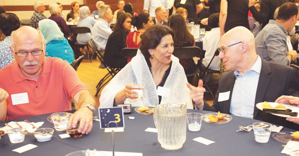 Jewish Federation President and CEO Andrew Rehfeld (right) shares a laugh with Ghazala Hayat, former chairwoman of the Islamic Foundation of Greater St. Louis, during an Iftar dinner hosted by the Jewish community at the J. At left is Rick Abrams.