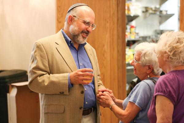 Rabbi Hyim Shafner says goodbye to community members during a gathering Sunday at Bais Abraham Congregation in University City.Photo: Bill Motchan